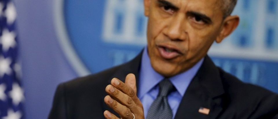 U.S. President Obama gestures as he holds his end of the year news conference at the White House in Washington
