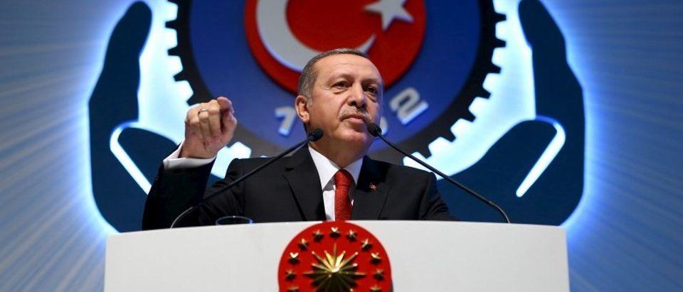 Turkey's President Tayyip Erdogan addresses the audience during a meeting in Ankara