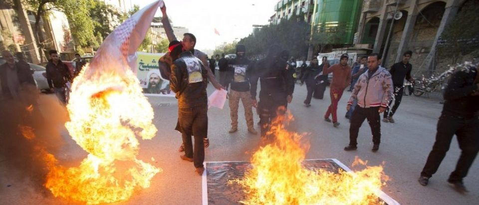 Supporters of Shi'ite cleric Moqtada al-Sadr burn posters of King Salman of Saudi Arabia against the execution of Shi'ite Muslim cleric Nimr al-Nimr in Saudi Arabia, during a demonstration in Kerbala