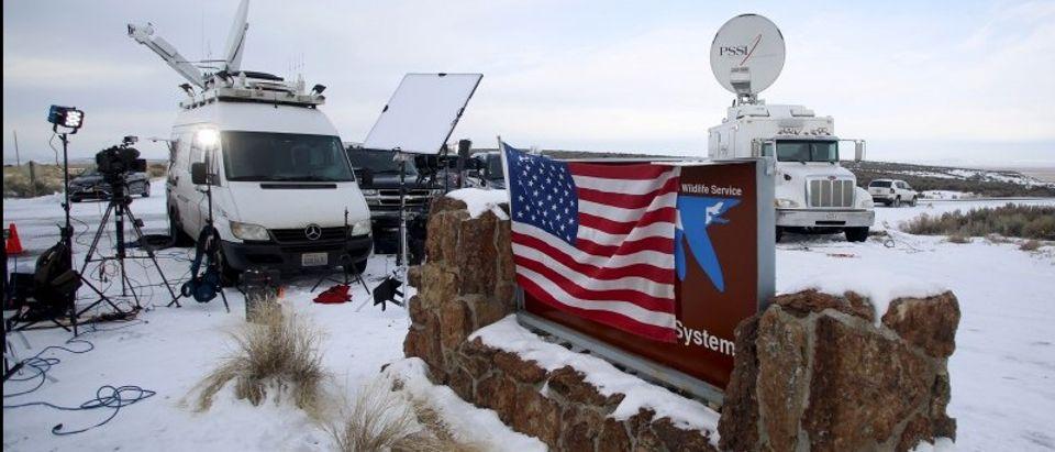 Media and satellite trucks are seen at the Malheur National Wildlife Refuge near Burns