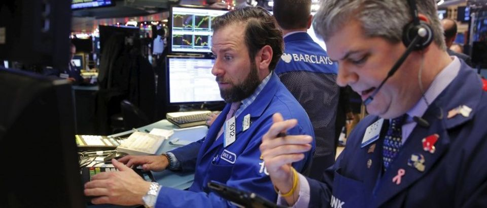 Traders work on the floor of the New York Stock Exchange (NYSE) shortly before the closing bell in New York