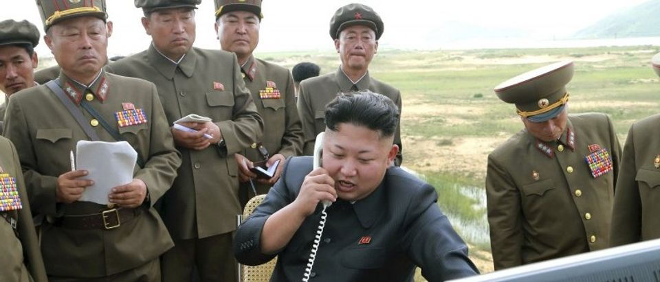 North Korean leader Kim Jung Un guides the test fire of a tactical rocket in this undated file photo