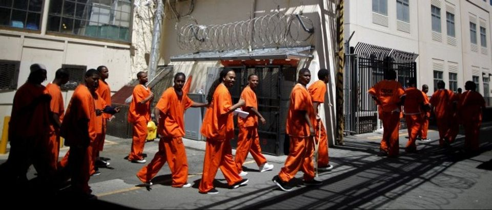 Inmates walk in San Quentin state prison in San Quentin, California, in this June 8, 2012 file photo. REUTERS/Lucy Nicholson/ Files