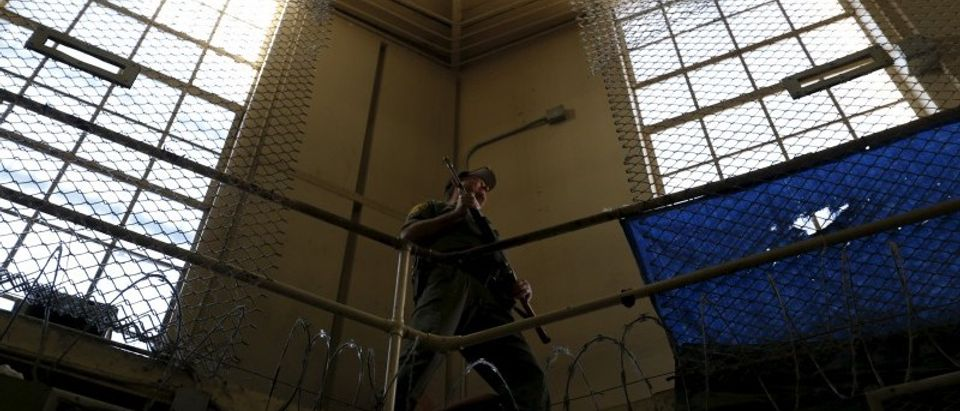 An armed guard patrols the East Block for condemned prisoners during a media tour of San Quentin State Prison in California