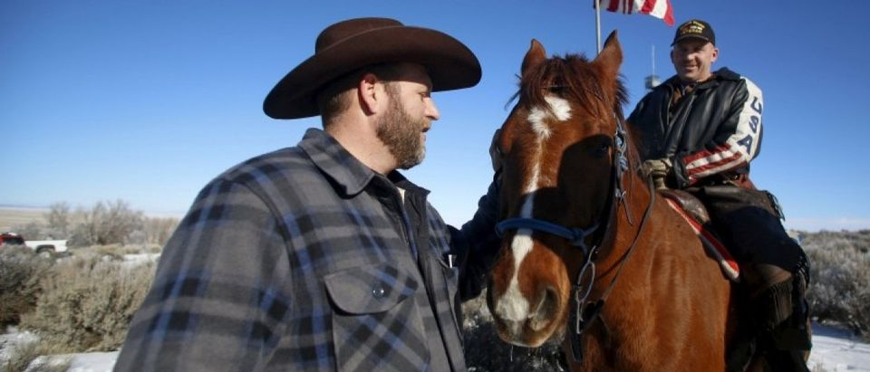 Leader of a group of armed protesters Ammon Bundy greets occupier Duane Ehmer and his horse Hellboy at the Malheur National Wildlife Refuge near Burns, Oregon