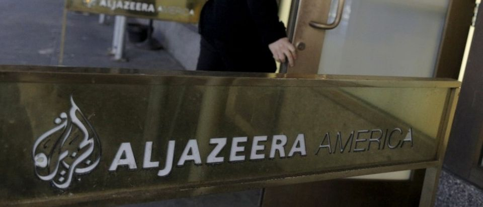 An employee enters the Al Jazeera America broadcast center in midtown Manhattan in New York