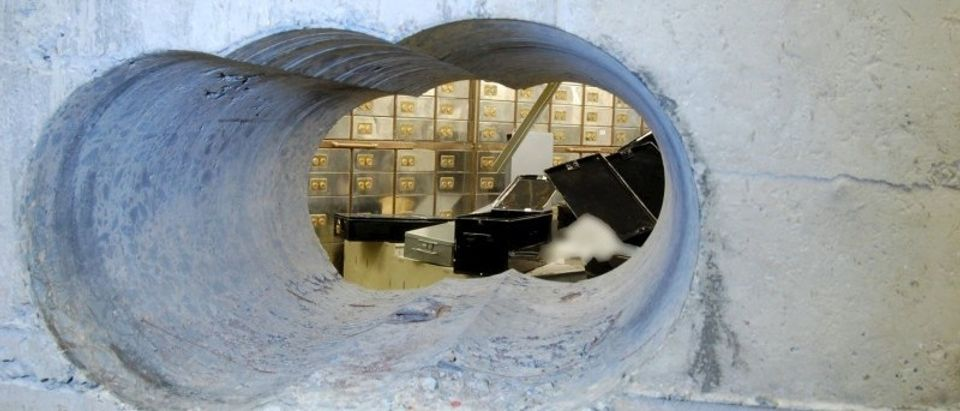 Handout photo of the hole that robbers drilled through the concrete vault during the Hatton Garden heist in London