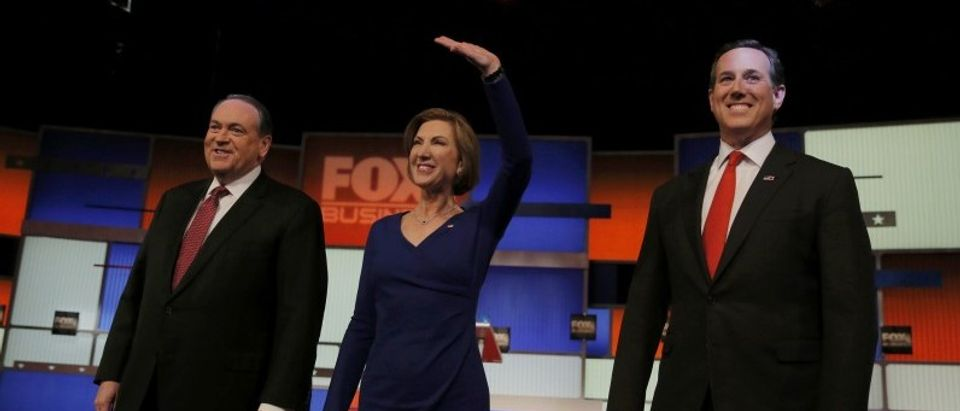 Huckabee, Fiorina and Santorum pose together before the start of their debate for lower polling candidates at the Fox Business Network Republican presidential candidates debate in North Charleston