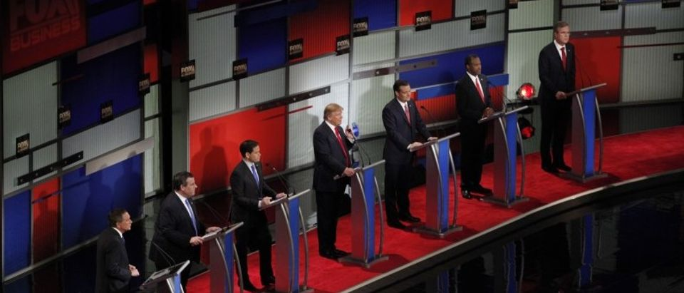 Republican U.S. presidential candidate businessman Donald Trump speaks as he stands amongst six rivals for the Republican presidential nomination during the Fox Business Network Republican presidential candidates debate in North Charleston