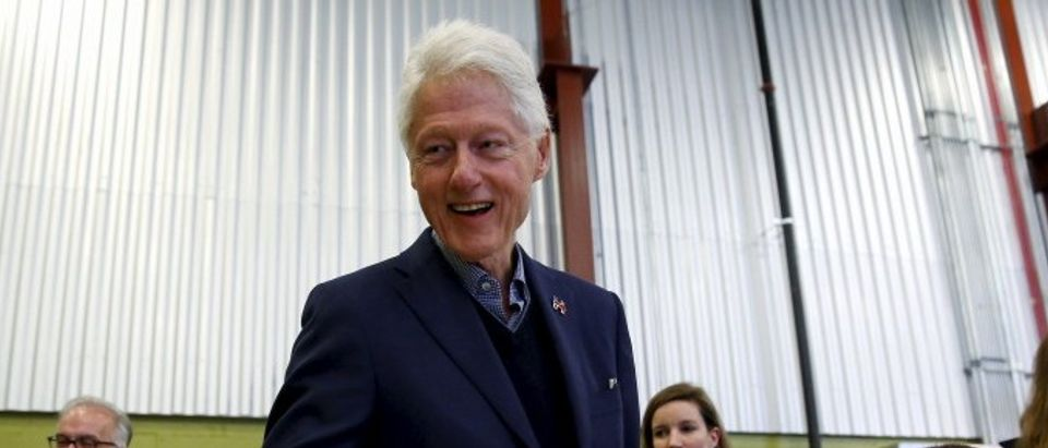 File photo of former U.S. President Clinton greeting customers and employees while campaigning in Cedar Rapids
