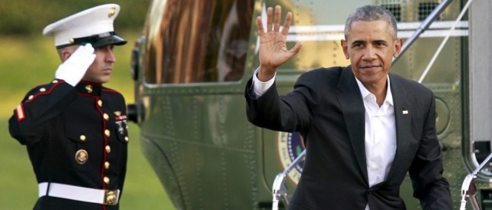 U.S. President Barack Obama waves as he walks on the South Lawn of the White House upon return to Washington from Louisiana