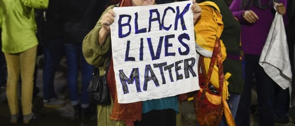 Black Lives Matter protesters chant slogans at the Mall of America light rail station in Bloomington