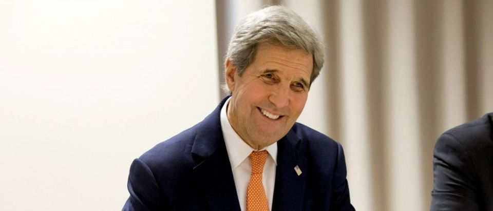 U.S. Secretary of State John Kerry smiles as he begins meeting on Syria with Russian Foreign Minister Sergey Lavrov, in Zurich