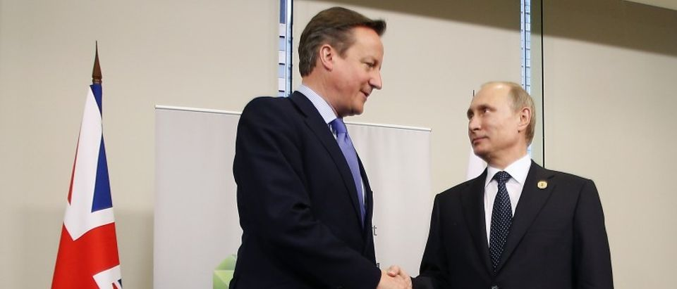 British Prime Minister Cameron shakes hands with Russian President Putin during their bilateral meeting on the side of the G20 leaders summit in Brisbane