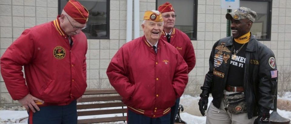 A group of retired military veterans gather to welcome back former U.S. Marine Amir Hekmati, recently released from an Iranian prison, arriving at an airport in Flint, Michigan