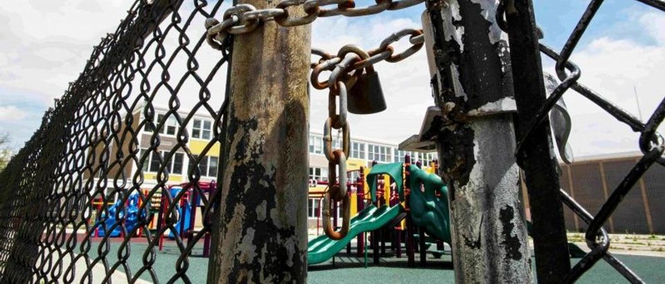 A playground is seen behind a locked gate at Woods Elementary Math & Science Academy in Chicago in this file photo