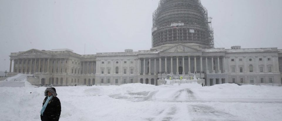 A person walks on the snow-covered grounds of the U.S.Capitol in Washington
