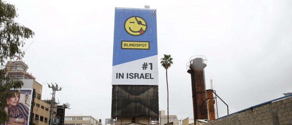 A billboard advertisement for Israeli app Blindspot, which allows people to send text messages anonymously, is seen in Tel Aviv
