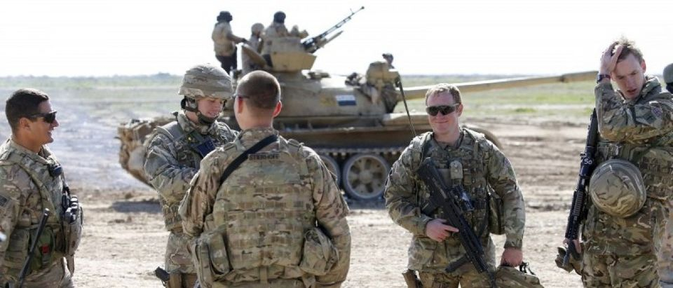 U.S.-led coalition instructors monitor as they train Iraqi soldiers from the army's 72nd infantry brigade while participating in a joint live ammunition exercise at Besmaya military base in south of Baghdad, Iraq, January 27, 2016. REUTERS/Thaier Al-Sudani