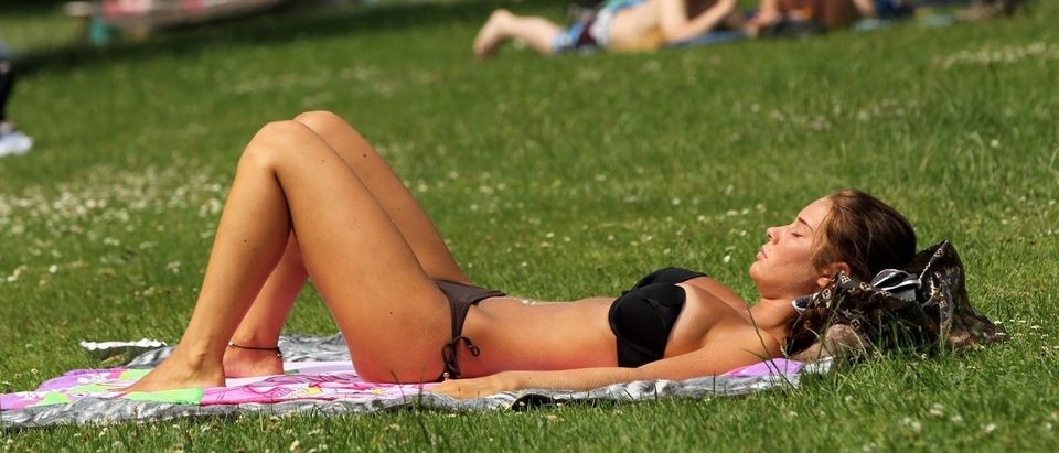 A young woman sunbathes at a public pool on July 1, 2010 in Kleinmachnow near Berlin, Germany. Temperatures are predicted to continue to climb in coming days and reach 37 degrees Celsius (about 99 degrees Fahrenheit) in Berlin. (Sean Gallup/Getty Images)
