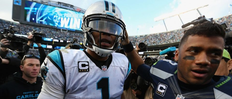 CHARLOTTE, NC - JANUARY 17: Cam Newton #1 of the Carolina Panthers shakes hands with Russell Wilson #3 of the Seattle Seahawks after the NFC Divisional Playoff Game at Bank of America Stadium on January 17, 2016 in Charlotte