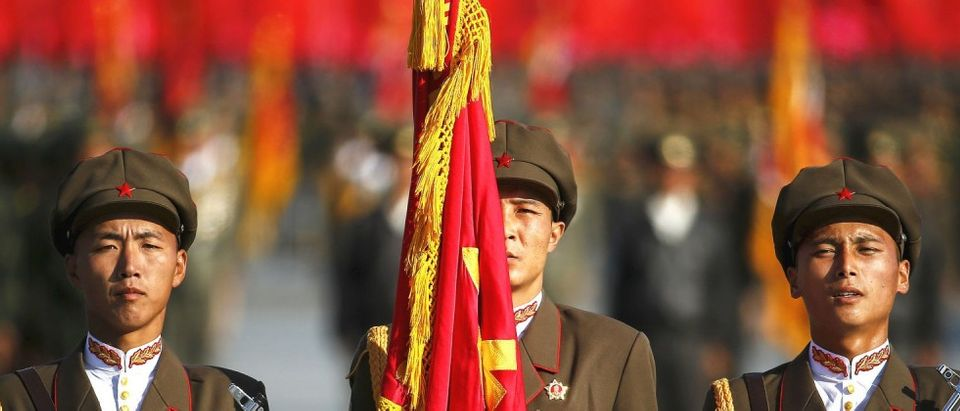 North Korean soldiers stand guard at the beginning of the parade celebrating the 70th anniversary of the founding of Workers' Party of Korea in Pyongyang October 10, 2015. Isolated North Korea marked the 70th anniversary of its ruling Workers' Party on Saturday with a massive military parade overseen by leader Kim Jong Un, who said his country was ready to fight any war waged by the United States. REUTERS/Damir Sagolj