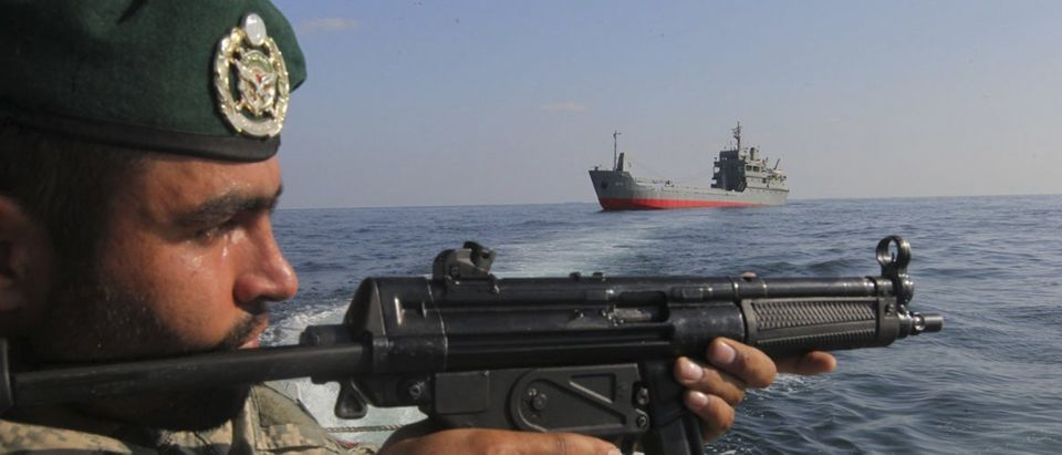 Military personnel participates in the Velayat-90 war game on Sea of Oman near Strait of Hormuz in southern Iran