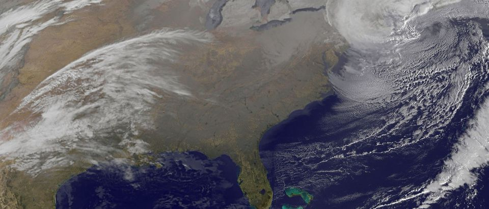 NOAA's GOES-13 satellite image shows two low pressure systems that came together and formed a giant nor'easter centered right over New England