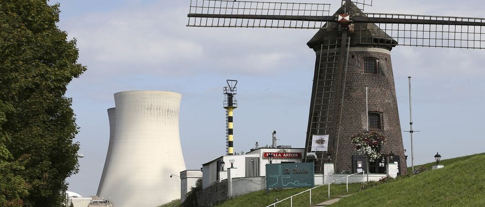 A windmill is seen near the Doel's nuclear plant in northern Belgium August 20, 2014. Two Belgian nuclear reactors owned by GDF-Suez unit Electrabel may remain offline until spring and may need to be halted permanently. REUTERS/Francois Lenoir