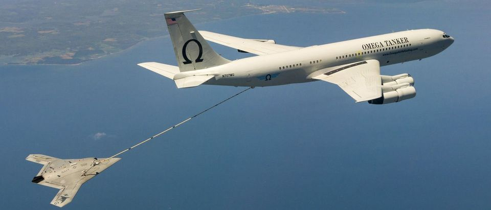 The Navy's unmanned X-47B aircraft receives fuel from an Omega K-707 tanker plane while operating in the Atlantic Test Ranges over the Chesapeake Bay Maryland