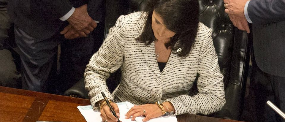 South Carolina Governor Haley signs legislation permanently removing the Confederate battle flag from the state capitol grounds in Columbia