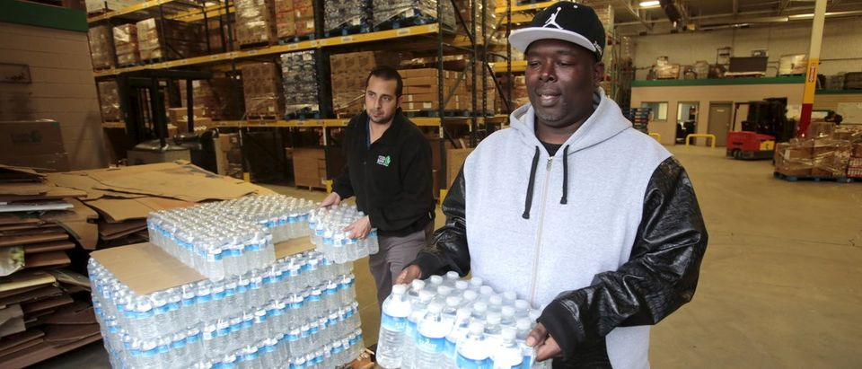 Man picks up bottled water from the Food Bank of Eastern Michigan to deliver to a school after elevated lead levels were found in the city's water in Flint