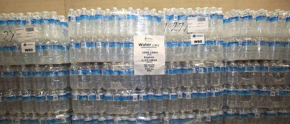 The Food Bank of Eastern Michigan holds stacks of bottled water in the agency's warehouse that will be distributed to the public, after elevated lead levels were found in the city's water in Flin