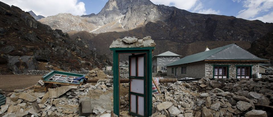 A door of a collapsed house stands after the earthquake damaged it earlier this year at Khumjung, a typical Sherpa village in Solukhumbu district also known as the Everest region