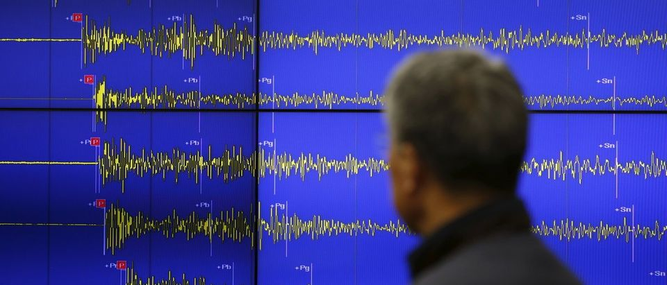 An employee looks at seismic waves observed in South Korea, during a media briefing at Korea Meteorological Administration in Seoul