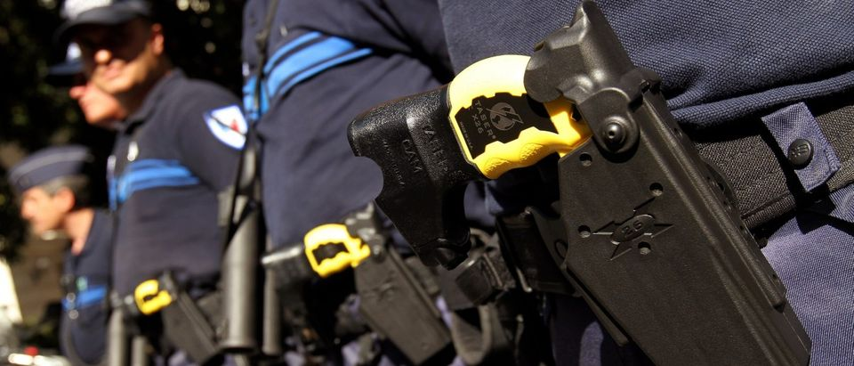 Municipal police in Nice pose with the Taser X26 model in their holsters