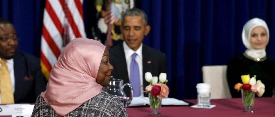 Muslim American community leaders sit for a roundtable discussion with Obama at the Islamic Society of Baltimore mosque in Catonsville, Maryland