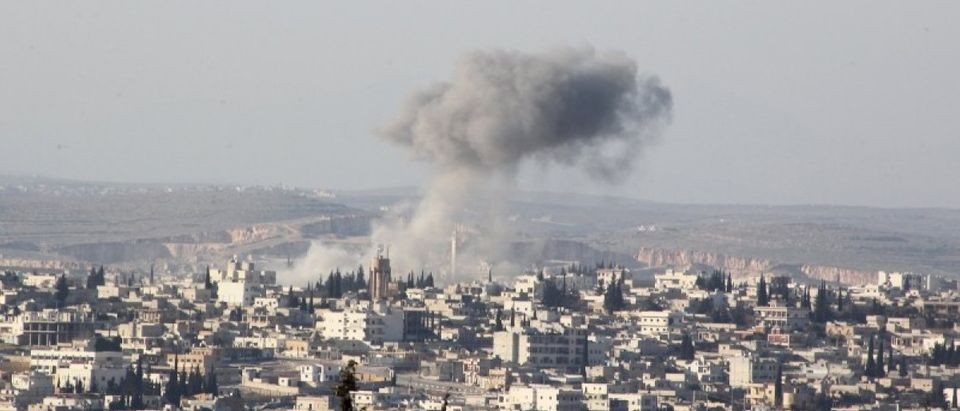 Smoke rises after airstrikes by pro-Syrian government forces in Anadan city
