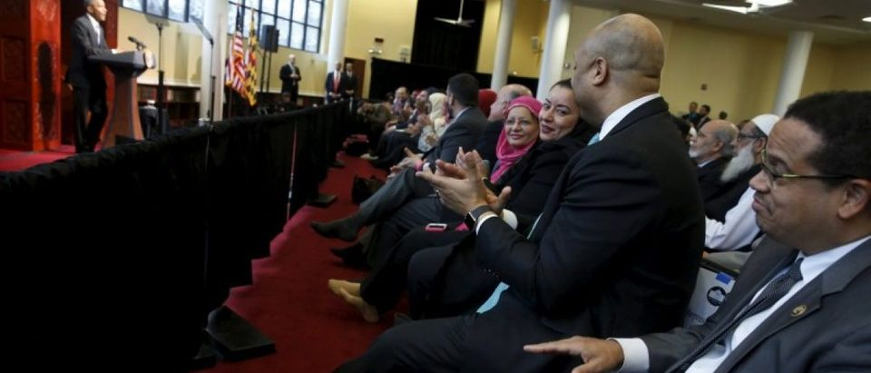 U.S. Representative Keith Ellison (D-MN) (R) applauds with other members of the audience as U.S. President Barack Obama (L) delivers remarks at the Islamic Society of Baltimore mosque in Catonsville, Maryland February 3, 2016. REUTERS/Jonathan Ernst
