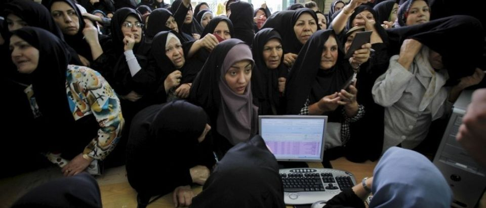 File picture of Iranian women waiting to cast their votes during the Iranian presidential election, in Tehran