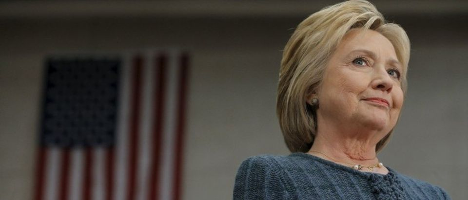 """Democratic presidential candidate Hillary Clinton listens as she is introduced at a """"Get Out the Vote"""" campaign rally in Concord"""