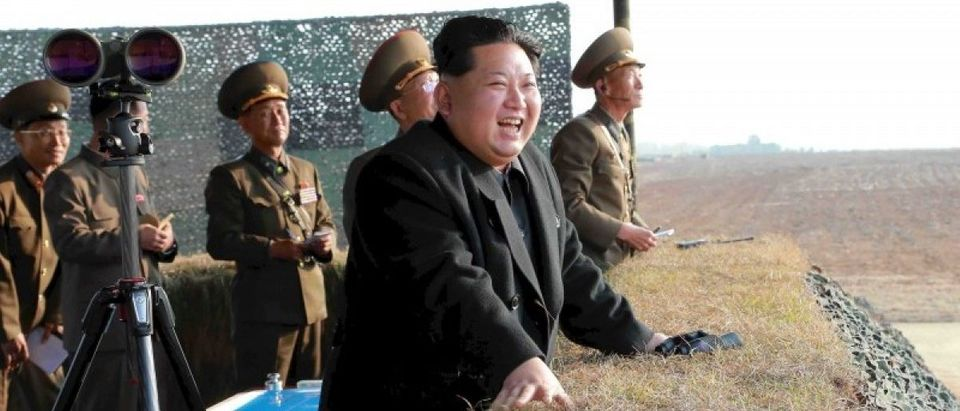 File picture shows North Korean leader Kim Jong Un watching a rocket firing drill by anti-aircraft units of the Korean People's Army