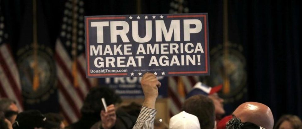 A supporter holds a placard at Republican U.S. presidential candidate Donald Trump's 2016 New Hampshire presidential primary election night rally in Manchester