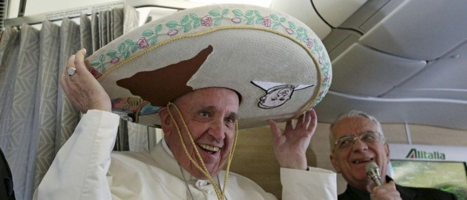 Pope Francis wears a Sombrero hat he received as a gift by a Mexican journalist aboard of the airplane to Havana