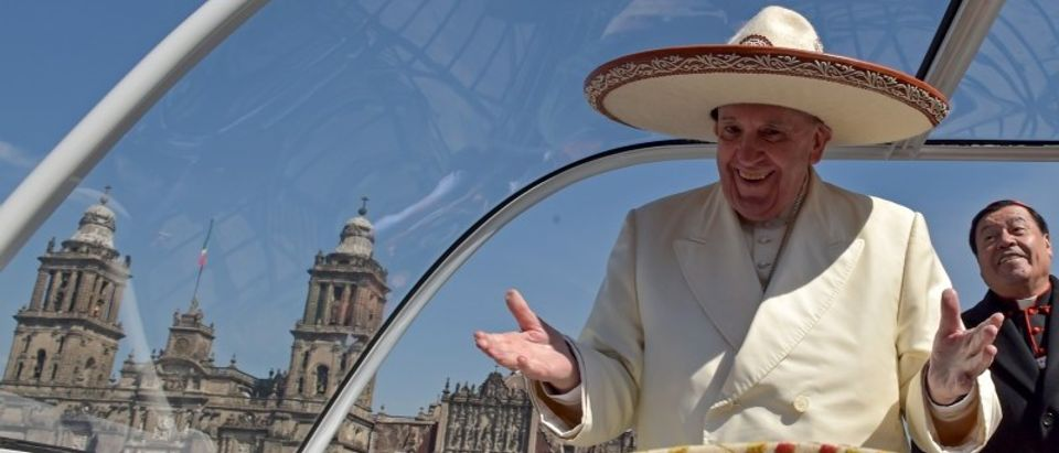 Handout of Pope Francis gesturing while wearing a Mariachi hat given to him by someone in the crowd on Zocalo Square in Mexico City