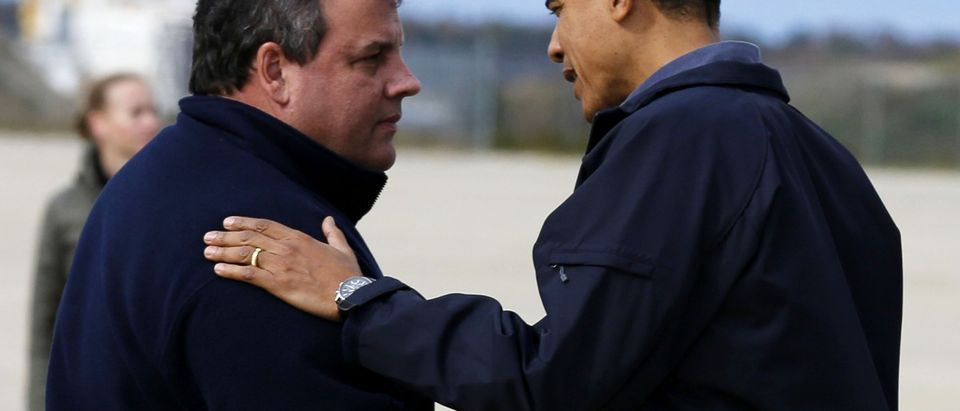 President Obama talks to New Jersey Governor Christie after arriving at airport in New Jersey