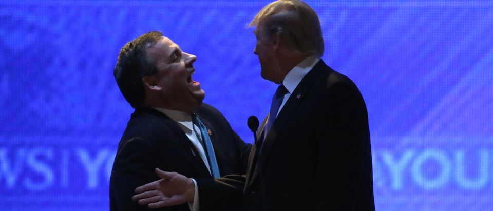 Republican presidential candidate Gov. Chris Christie and rival candidate Donald Trump laugh together during a commercial break in the midst of the Republican presidential candidates debate sponsored by ABC News at Saint Anselm College in Manchester