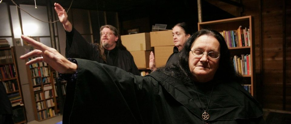 Wicca religion practitioners Rev. Don Lewis (L), Rev. Krystal High-Correll (C), and Rev. Virgina Powell HPS, participate in a Wiccan Lunar ritual in the temple at the Witch School October 25, 2006 in Hoopeston, Illinois. (Scott Olson/Getty Images)