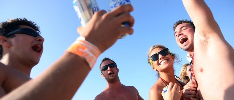 Students drink on the beach during the annual ritual of Spring Break March 25, 2008 on South Padre Island, Texas. (Rick Gershon/Getty Images)