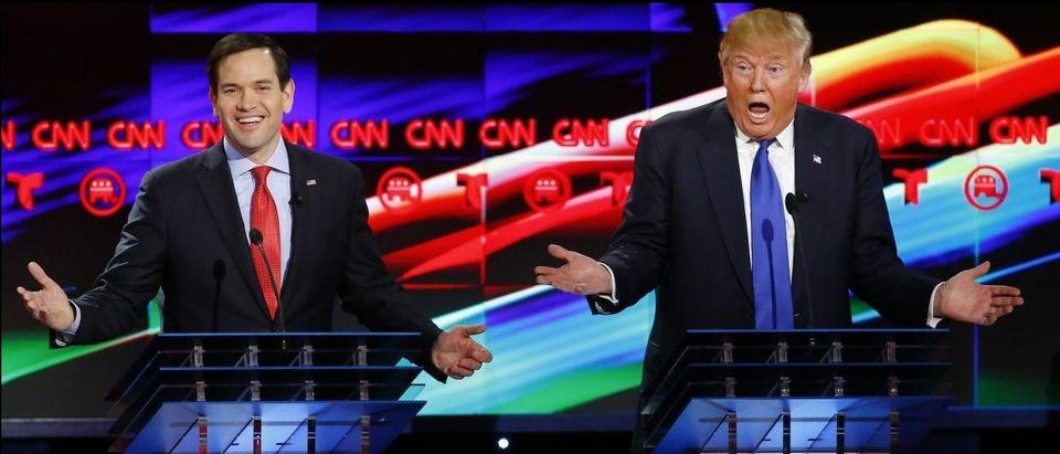 Republican presidential candidates Marco Rubio and Donald Trump react to each other as they discuss an issue during the debate sponsored by CNN for the 2016 Republican presidential candidates in Houston